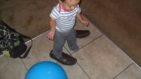 Trying on Daddy's shoes!